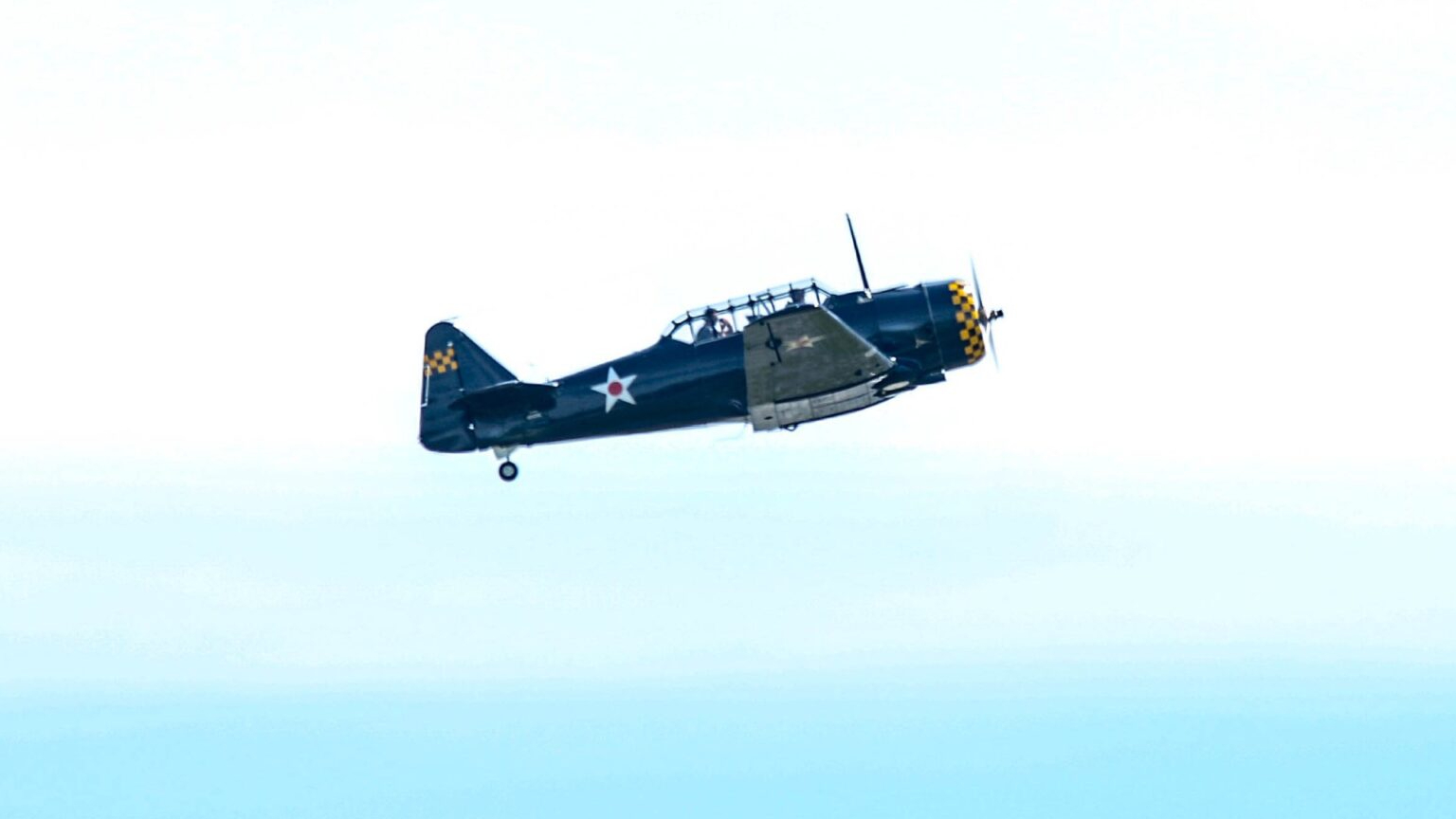 Dark blue airplane with a star