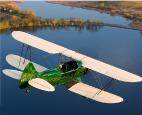 Green Vintage Airplane in flight